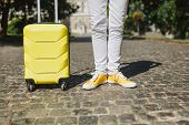 Cropped Image Of Traveler Tourist Woman Legs In Yellow Summer Casual Clothes With Suitcase On Road I poster