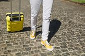 Cropped Image Of Traveler Tourist Woman Legs In Yellow Summer Casual Clothes With Suitcase Walking I poster