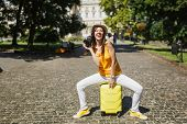 Laughing Traveler Tourist Woman In Casual Clothes Sitting On Suitcase With Retro Vintage Photo Camer poster