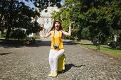 Shocked Traveler Tourist Woman In Yellow Clothes, Hat Sitting On Suitcase Hold City Map Spreading Ha poster