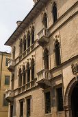 stock photo of vicenza  - Facade of palace in Vicenza Italy with typical balcony with columns - JPG