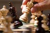 image of battle  - playing wooden chess pieces - JPG
