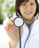 Asian medical student with stethoscope in hand