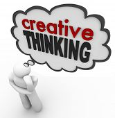 A person thinks of the words Creative Thinking to represent brainstorming, thought, creativity, insp