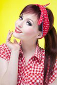 stock photo of rockabilly  - Cheerful pin up girl  - JPG