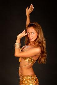 foto of belly-dance  - beautiful long hair blonde woman in arabic dance costume  - JPG