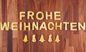 stock photo of weihnachten  - the german words Frohe Weihnachten which means merry christmas with cookies - JPG