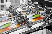 stock photo of manufacturing  - Close up of an offset printing machine during production - JPG