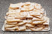 picture of frappe  - Chiacchiere or frappe italian cake on table - JPG