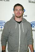 ANAHEIM, CA - MARCH 31: Stephen Amell arrives at the 2013 Wondercon convention press room at the Ana