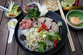 image of rice noodles  - Vietnamese rice noodles are served with beef lime sauce and chili sauce and ready to eat.