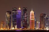 stock photo of qatar  - Doha downtown skyline at night Qatar Middle East - JPG