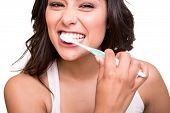 stock photo of human teeth  - Smiling young woman with healthy teeth holding a tooth brush - JPG