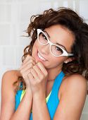 stock photo of shy woman  - Young attractive shy woman wearing glasses - JPG