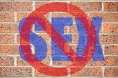 "stock photo of transgendered  - ""No sex"" sign on red brickwall surface as a concept of homophobia or abstinence - JPG"