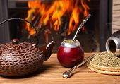 pic of calabash  - Mate in the calabash kettle yerba on fire background - JPG