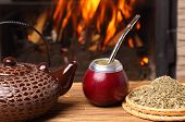 foto of calabash  - mate in the calabash kettle yerba on fireplace background - JPG
