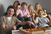 stock photo of underage  - Teenagers Having Fun And Eating Pizza - JPG