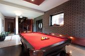 picture of penthouse  - A big red pool table in a luxurious interior - JPG
