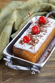 stock photo of pound cake  - pound cake with powdered sugar and berries - JPG