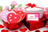 stock photo of valentine candy  - Happy Valentines Day card with gifts and bowl of cookies - JPG