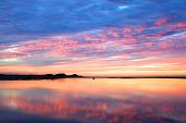stock photo of shoreline  - Beautiful sunset image over ocean in the Whitsundays - JPG