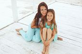 pic of 7-year-old  - Mother with her 7 years old daughter having fun at beach in summer - JPG