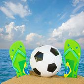 image of brasilia  - football ball in sand with sandals in brasilia colors on ocean coast - JPG