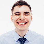 pic of sarcasm  - Film toned grainy portrait of laughing young employee - JPG