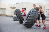 picture of heavy  - A group or team flipping heavy tires outdoor - JPG