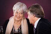 stock photo of ear candle  - Happy Senior Couple Dining Together With Wine In A Restaurant - JPG