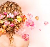 stock photo of perm  - Hairstyle with colorful flowers - JPG