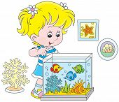 picture of kiddie  - Little girl watching colorful tropical fish in an aquarium - JPG