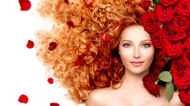 pic of perm  - Beauty model girl with long curly red hair and beautiful red roses hairstyle - JPG