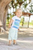 picture of laughable  - Baby walking in the park - JPG