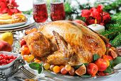 foto of turkey dinner  - Roasted turkey on holiday table - JPG