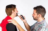 pic of barber razor  - Barber trimming a beard with an electric razor - JPG