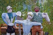 image of scarecrow  - Scarecrow famil shoving sign with message for respect - JPG
