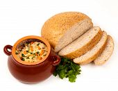 picture of pot roast  - roast with greens sauce bread and tomato in a brown clay pot - JPG