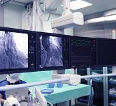 foto of pacemaker  - The set  of X-ray monitors in hospital .