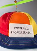 foto of enterprise  - Colorful hat with green propeller with sign that says - JPG