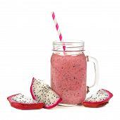 stock photo of dragon fruit  - Pink raspberry dragon fruit smoothie in jar mug with fruit slices isolated on white - JPG