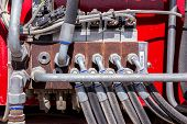 foto of spreader  - Mechanical parts of the big red tractor - JPG