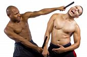 stock photo of filipino  - Two muscular martial artists demonstrating the Filipino Martial Art Kali Escrima or Arnis - JPG