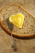 pic of ghee  - ghee or melted butter in heart shape on wholemeal bread - JPG