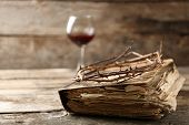 stock photo of crown-of-thorns  - Crown of thorns and bible on old wooden background - JPG
