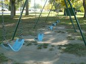 picture of swinger  - swings in the park waiting for the children to come and play - JPG