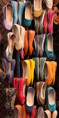 stock photo of shoes colorful  - Colourful women leather shoes on display in a bazaar in the Medina of Marrakech Morocco - JPG
