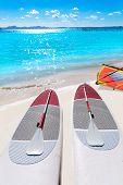 stock photo of paddling  - Platja de Alcudia beach Paddle surf board in Mallorca Majorca at Balearic islands - JPG