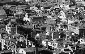 stock photo of overpopulation  - Venice Italy many houses seen from the campanile di san marco in black and white - JPG